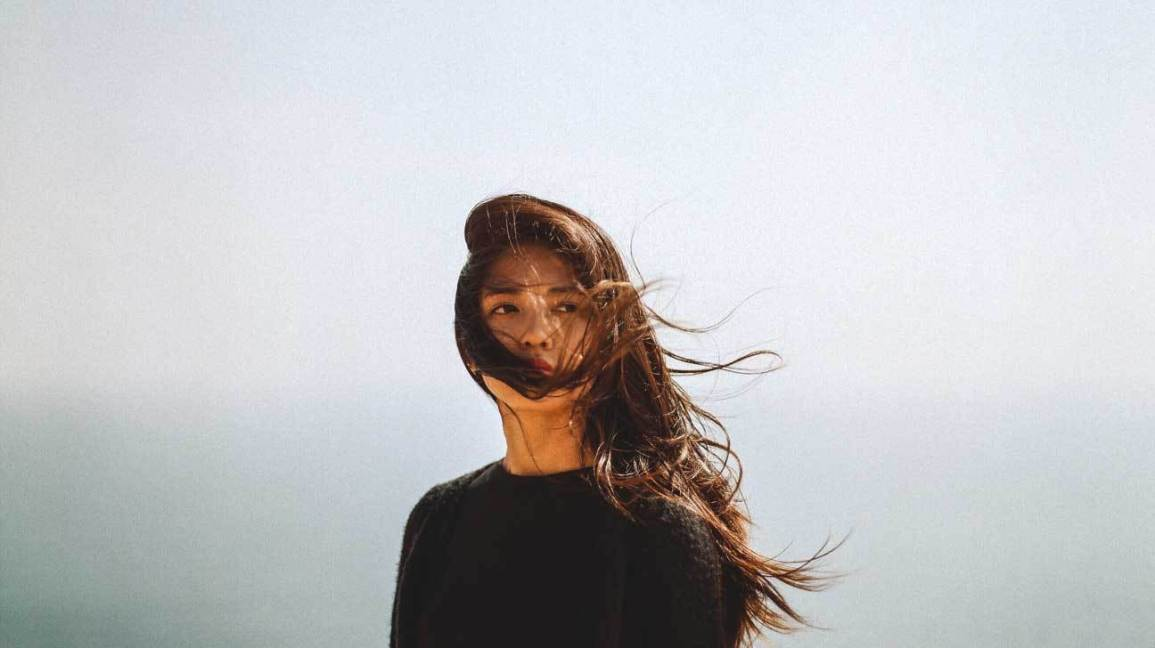 female_serious_outdoors-1296x728-header